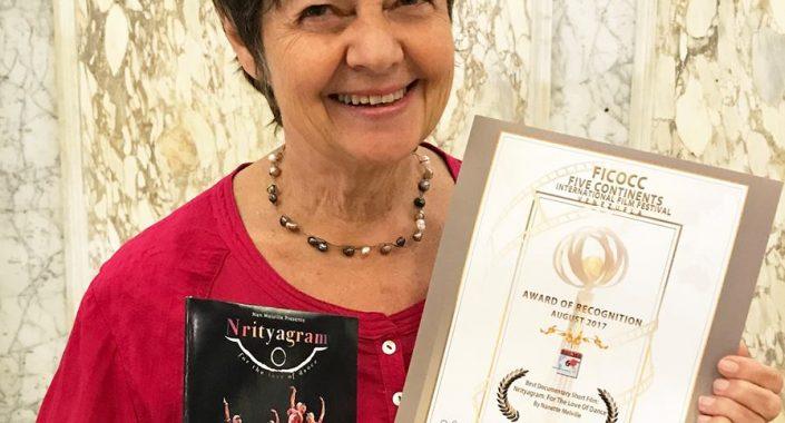 Nan holding her award
