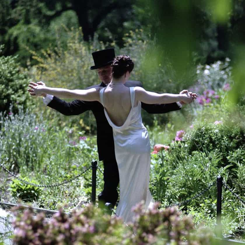 Bridal couple dancing in garden