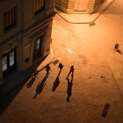 visitors from above at night, shadows, in Plaza San Francisco, Havana, Cuba