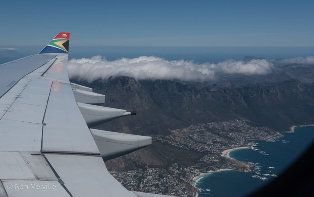 Wing of South African Airways jet flying over Cape Town, South Africa