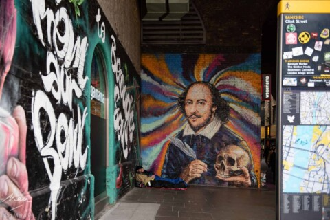 Shakespeare painted as a mural onto the wall under the bridge - Southbank, London