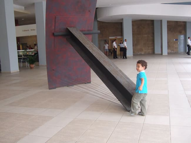 Little boy plays on exhibit at art gallery Havana, Cuba, 2006